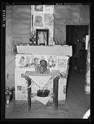 Fireplace closed with screen decorated with newspapers in temporary home of FSA (Farm Security Administration) clients near Transylvania, Louisiana by Historic Photos