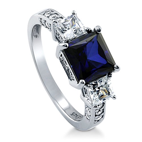 - BERRICLE Rhodium Plated Sterling Silver Simulated Blue Sapphire Princess Cut Cubic Zirconia CZ 3-Stone Anniversary Engagement Ring 3.13 CTW Size 6