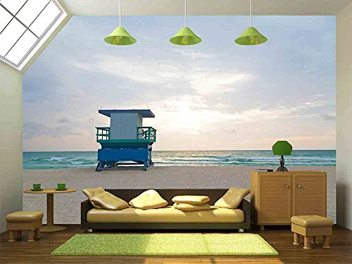 wall26 - Empty beach with lifeguard cabin at sunrise A lonely cabin on the empty beach - Removable Wall Mural   Self-adhesive Large Wallpaper - 100x144 (South Seas Hut)