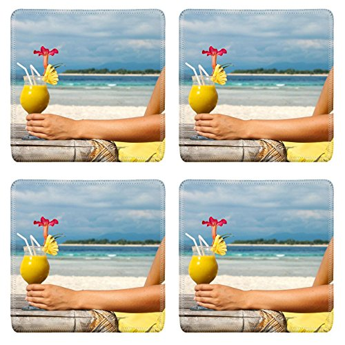 msd-natural-rubber-square-coasters-image-id-12598775-woman-holding-a-fruit-cocktail-on-a-tropical-be