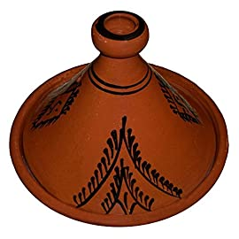 Moroccan Lead Free Cooking Tagine 100% handmade Clay Cookware 1 <p>Simple and functional, this authentic, handcrafted Moroccan cooking Tagine is ready to be used for your next flavorful and exotic Moroccan meal.The Tagine is to be use on the top of electrical or glass stove or inside the stove. If you have a gas stove with flames please use a protective metal piece to protect your Tagine from cracking. HOW TO CURE A TAGINE? It is necessary that it is seasoned before initial use. Please follow these simple instructions below for maximum results: 1. WATER: The new tagine needs to be first submerged in water for at least 1 hour. If you can't submerge it, place it in a clean sink bowl and slowly fill the base of the tagine with water until it stops absorbing it. Place the tagine lid on top and fill it as well. Let stand for 30 minutes to allow full absorption of water into the clay. Empty excess water and set to dry for 5 minutes. 2. OLIVE OIL: All you need is 3 table spoons of olive oil, 2 for the base and one for the lid. Spread the olive oil throughout the base and lid with your hand. 3: HEAT: While the tagine is still wet with the oil applied to it, place it in the oven as shown in the first or second photos, and set temperature at 350 F and leave for 45 minutes. The evaporation of moisture creates a vacuum effect to pull the olive oil into the clay which glazes and seals it. Then leave the tagine cool down in the turned off oven.TAGINE MUST BE COOKED IN LOW TEMPERATURES AND A DIFFUSER IS RECOMMANDED TO AVOID BREAKAGE Handmade cooking tagine Large 12.2 inches in Diameter Ideal for cooking on top of any kind of stove and inside the oven Traps condensation to keep food moist and infused easy to clean 100% lead free Guaranty Safe Cooking made from natural clay If you have a gas stove, make sure you use a diffuser or a simmer to protect your Tagine from cracking</p>