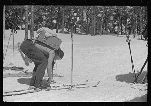 (1939 Photo Forest ranger bringing in supplies which he has carried up the mountain on skiis to his hut which is also used by skiers in the winter. About half)