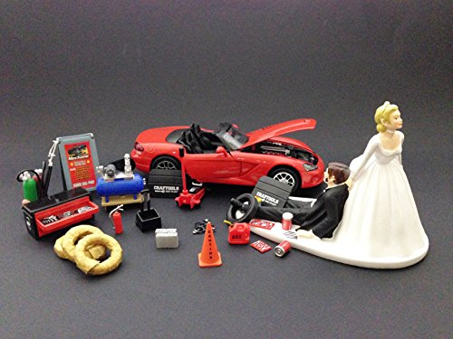 auto-mechanic-car-loving-groom-being-dragged-by-bride-wedding-cake-topper-with-red-2003-dodge-viper-