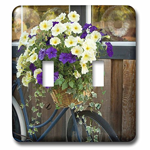 Danita Delimont - Canada - Vancouver Island. Flowers, bicycle in front of bakery, Cowichan Bay - Light Switch Covers - double toggle switch (lsp_226780_2)