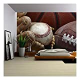 wall26 - Close Up Shot of Well Worn Baseball in Baseball Glove, Football and Basketball - Removable Wall Mural | Self-adhesive Large Wallpaper - 100x144 inches