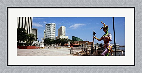 Jester statue with buildings in the background, Riverwalk Area, New Orleans, Louisiana, USA by Panoramic Images Framed Art Print Wall Picture, Flat Silver Frame, 35 x 17 - Louisiana Riverwalk