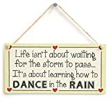 Life isn't about waiting for the storm to pass It's about learning how to dance in the rain - Motivational Sign