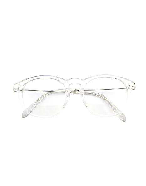 Estupendas gafas redondas con montura transparente y patillas metálicas.