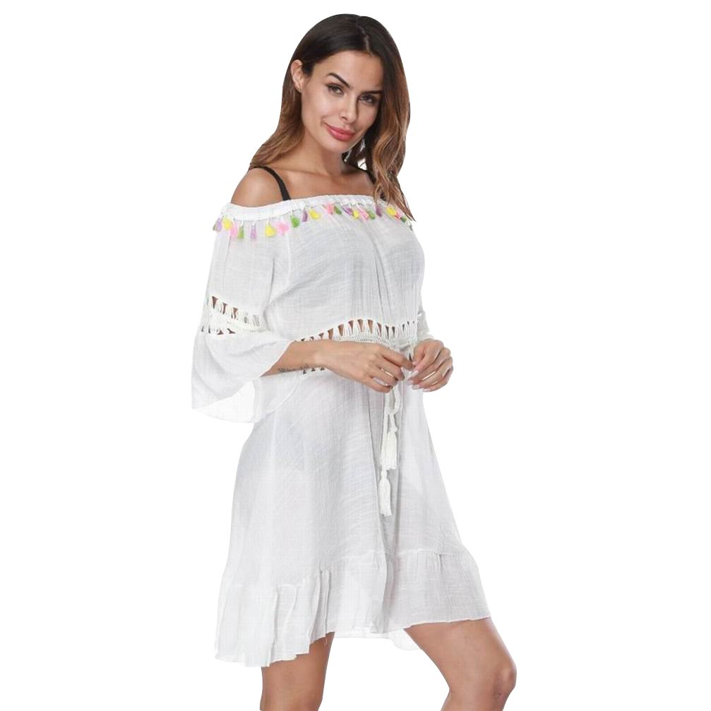 02bf03be43564 Off the shoulder bathing suit cover up, colorful tasseled details around  the neckline. Fringe drawstring tie at waistline, short sleeve, hollow out