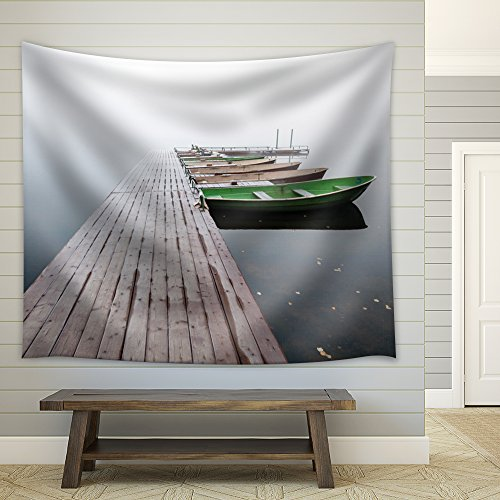 Jetty Leading to Boats That Are Sitting on the Ocean Fabric Tapestry