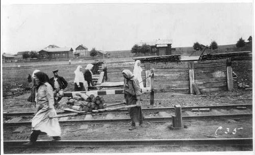 HistoricalFindings Photo: Women Carrying Wood,Railroad Yard,RR,Train Station,Petrograd,Russia,c1920