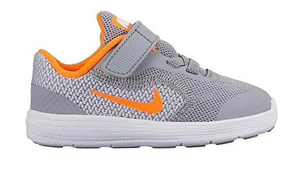 Nike Revolution 3 (TDV), Zapatos de Primeros Pasos Unisex Bebé, Negro (Stealth/Total Orange-White), 21 EU