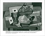 """Size Size of photo 8"""" x 10.1""""    Works by Georges Braque, Still life with Grapes and Clarinet, 1927, oil on canvas. The Philip collection, Washington D. C. This photograph originates from the International Magazine Services photo archive. IMS was..."""