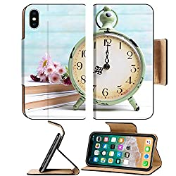 Luxlady Premium Apple iPhone X Flip Pu Leather Wallet Case IMAGE ID: 34432088 Beautiful flowers with clock and book on table on light blue background