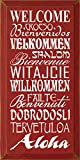 This is a solid wood sign with a Welcome theme.  Saying: Welcome - Croeso - Bienvenidos - Velkommen - Shalom - Bienvenue - Witajcie - Willkommen - Failte - Benvenuti - Dobrodosli - Tervetuloa - Aloha  There is a routed slot in back for hangin...
