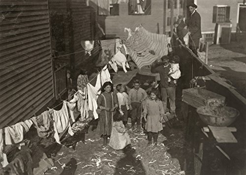 Hine Mill Housing 1912 Ntextile Mill WorkerS Family In The Yard With A Clothesline Covered With Laundry In Providence Rhode Island Photograph By Lewis Hine November 1912 Poster Print by (24 x 36)