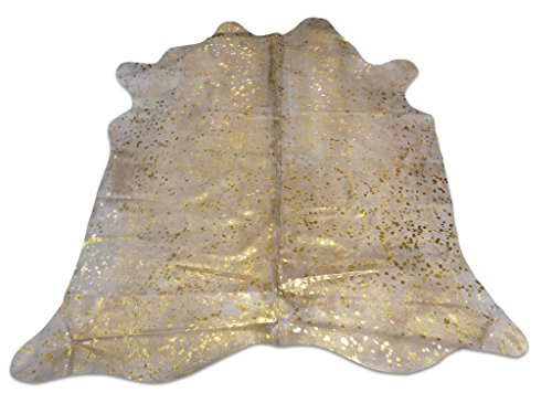 Metallic Cowhide Rug Gold on off white background by cowhidesusa