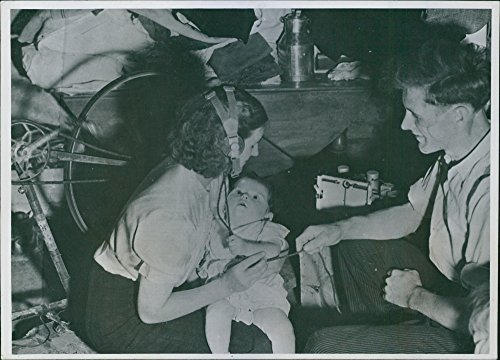 Vintage Photo Of A French Mother Holding Her Child Demonstrates How She Listened To Allied News With Her Husband