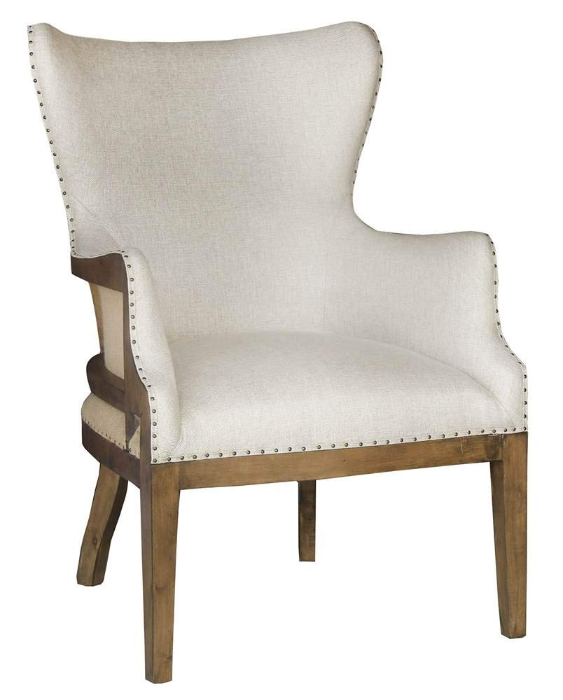 When you love the character and laid back charm of a European inspired deconstructed arm chair with nailhead trim...here's a thoroughly modern take .Unexpected details make it a unique addition to the dining room or den! I love the exposed burlap in a light toffee shade.