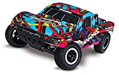 The award-winning Traxxas Slash short-course race truck puts you in the drivers seat for intense fender-to-fender, high-flying off-road action. The full-scale short-course race trucks embody the spirit of Traxxas R/C with their extreme 900+ h...