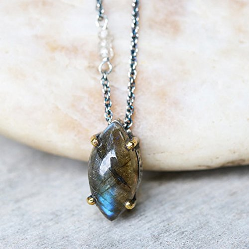 Marquis cabochon labradorite pendant necklace in silver bezel and brass prongs setting with aquamarine on the side on oxidized silver chain