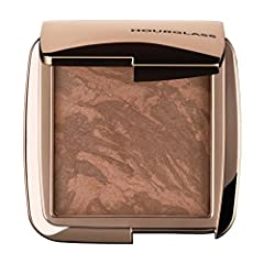 Ambient Lighting Bronzer fuses the illuminating effects of Ambient Lighting Powder with bronze pigments to add depth and dimension for a natural, sun-kissed glow. The sheer, airy formula sweeps on softly for a healthy-looking, radiant finish....
