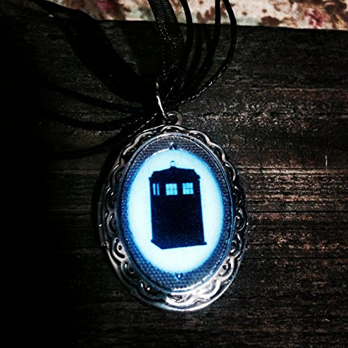 Doctor Who Tardis Silhouette Cameo Picture Locket glows Intensely Blue in the Dark T.A.R.D.I.S.