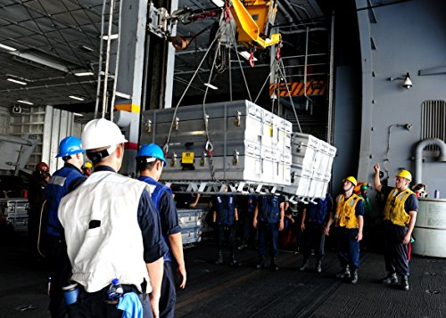 (Home Comforts Laminated Poster Sailors Aboard The Aircraft Carrier USS Theodore Roosevelt (CVN 71) Load Ammunition on The King Vivid Imagery Poster Print 24 x 36)