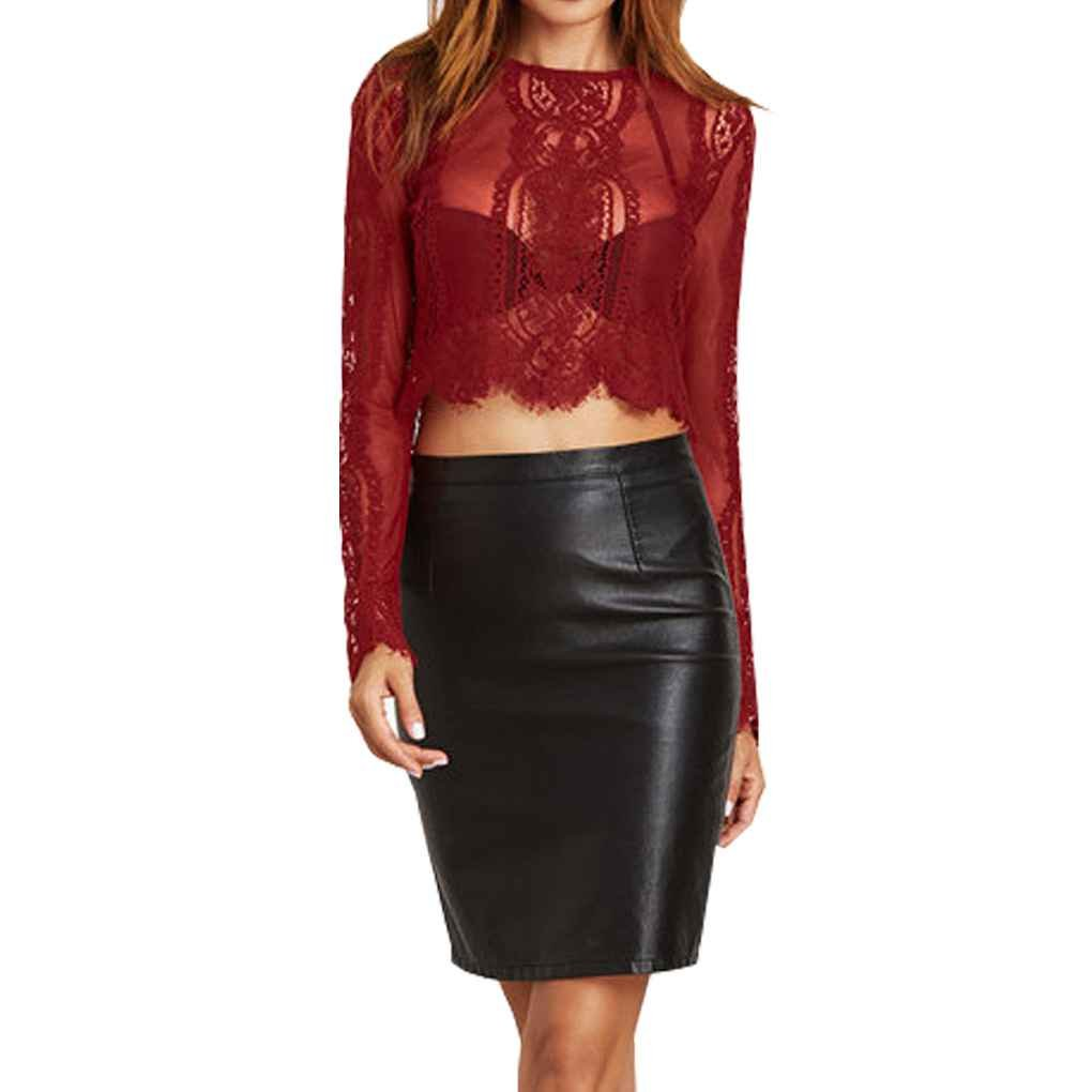 Sexy blusa de encaje con manga larga y cintura al aire.