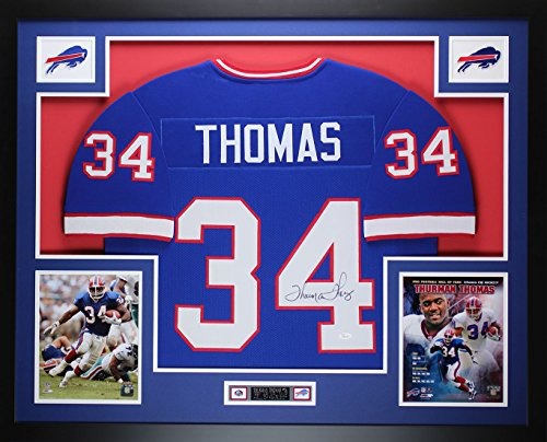 Thurman Thomas Autographed Blue Bills Jersey - Beautifully Matted and Framed - Hand Signed By Thurman Thomas and Certified Authentic by JSA COA - Includes Certificate of Authenticity