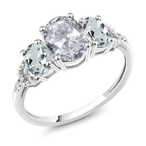 Gem Stone King 10K White Gold Diamond Accent 3-Stone Engagement Ring set with 2.21 Ct Oval White Topaz Sky Blue Aquamarine (Size 8)