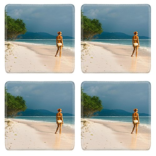 luxlady-square-coaster-young-woman-standing-at-the-beach-looking-far-into-the-ocean-image-22629756-c