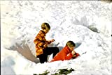 Vintage photo of Pierre and Andrea Casiraghi playing in the snow during a ski holiday in Zurs