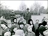 """Vintage photo of Evsei Liberman with some children in awe, while listening attentively during winter outdoors.""""Lieberman""""1966"""
