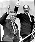"""Size Size of photo 6.4"""" x 7.6""""    British Labor Leader Harold Wilson and Labour Secretary of State Patrick Gordon-Walker wave at the departure of LondonHarold Wilson, Politician, British, Prime Minister, England, Economics This photograph origina..."""