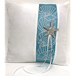 Beach theme wedding ring bearers pillow with a turquoise ribbon stripe, silver starfish with small rhinestones and a satin ribbon on the back for easy holding. Matching guestbook also available.
