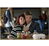 Awkwards Jillian Rose Reed as Tamara and Brett Davern as Jake Rosati embracing in the cafeteria 8 x 10 Inch Photo