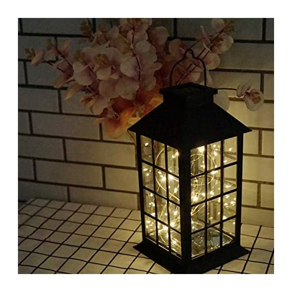 Solar Outdoor Lantern, Waterproof Hanging Solar Lantern with 30 LED Fairy Copper String Lights for Patio, Garden, Lawn, Pathway (Warm White) - CLASSIC DESIGN: Simple and elegant black frame rectangle shape with 30 LED warm fairy string lights, create a unique retro romance. SAFE LONG LIGHTING: Choosing the most popular string of lights inside the lantern instead of traditional candles, guarantees sufficient illumination without the danger of open flames. And after full charged, the solar lantern will automatically turn on at night and light up for 8 hours. PERFECT OUTDOOR DECOR: A movable hanging ring can be easily hung on anywhere, very suitable for your balcony, hallway, porch, courtyard, patio, garden, lawn. - patio, outdoor-lights, outdoor-decor - 519NXfGl2RL. SS570  -
