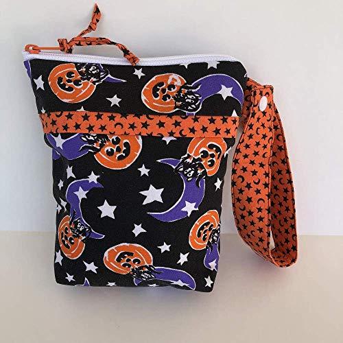 (Handmade Halloween inspired wristlet clutch bag, purse, girls, pumpkins, moons, stars and)