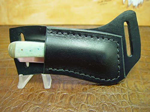 Custom Right-hand Cross Draw Trapper Style Folding Knife Leather Sheath handmade by Carl Thomas, Sheath Maker. Made Out of 10 Ounce Buffalo Hide Leather. BLACK