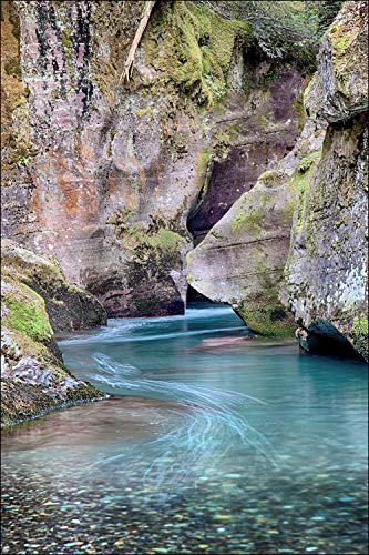 (Tranquil stream canyon landscape of turquoise water among colorful boulders)