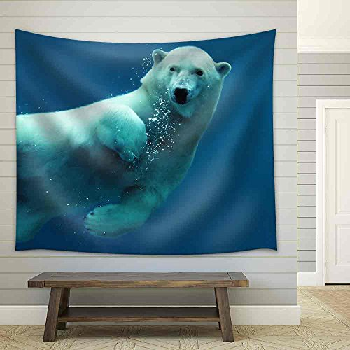 Close Up of a Swimming Polar Bear Underwater Looking at The Camera Fabric Wall