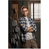 NCIS: Los Angeles (TV Series 2009 - ) 8 inch x 10 inch PHOTOGRAPH Barrett Foa Leaning Right Shoulder Against Beam Arms Crossed Over Plaid Shirt & Grey Tee kn