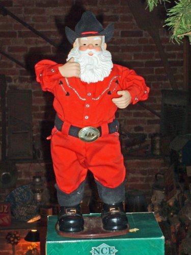 Singing Hip-Swingin' Holly Jolly Rock Santa Cowboy ()