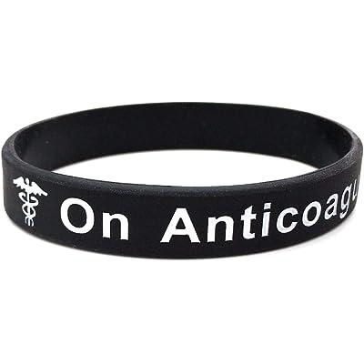 On Anticoagulant pulsera de silicona para alerta médica de emergencia. En blanco y negro pulsera con texto en inglés. 202mm. By Butler & Grace