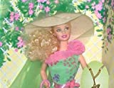 Wow! I have never seen a Barbie like this one. She has long spiral curls. She has blond hair and green eyes. She looks like a Southern Bell. With parason in hand, Barbie strolls along the winding garden path. Her beautiful gown with its delighful flo...