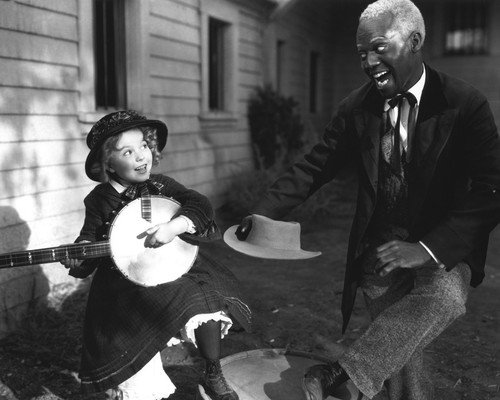 Shirley Temple and Bill Robinson in The Littlest Rebel sing tune together 11x14 Promotional Photograph
