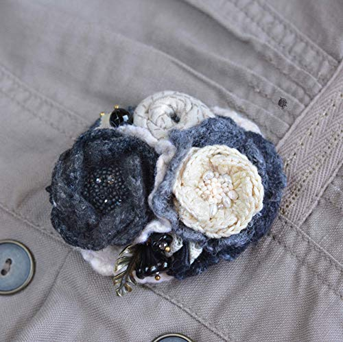 - Flower brooch black cream handmade knitted with natural stones
