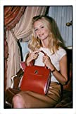 Vintage photo of Claudia Schiffer at a fashion show of handbags for Bulgari and UNICEF