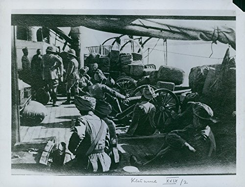 (Vintage photo of Soldiers sitting with their cannons in a ship,)